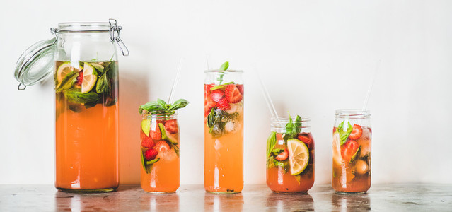 Fresh homemade strawberry and basil lemonade in tumblers wide composition