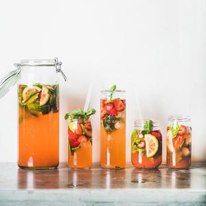 Homemade strawberry and basil lemonade or ice tea  square crop