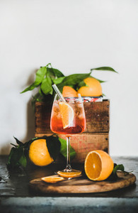 Aperol Spritz cocktail in glass with eco friendly straw copy space
