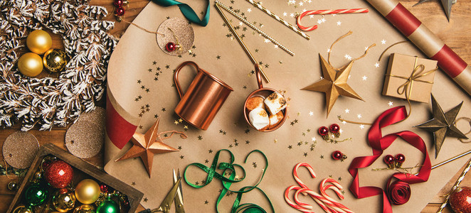 Hot chocolate and Christmas decoration over wooden background wide composition
