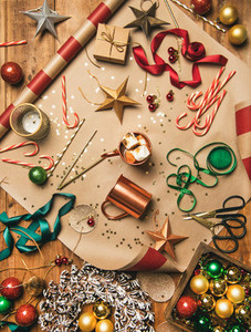 Hot chocolate and Christmas decoration over wooden background  vertical composition