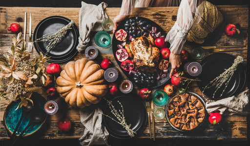 Thanksgiving party table setting with roasted chicken and fig pie