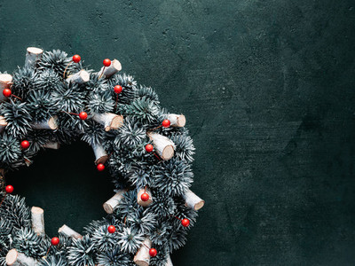 Beautiful Christmas wreath over a dark green background Top view flat lay copy space