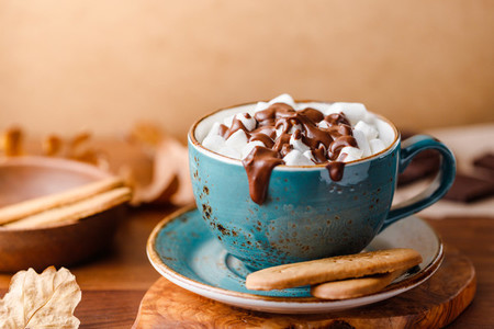 Close up of hot chocolate with marshmallows on the table Autumn or winter cozy still life