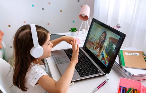 Girl watching online class of her teacher