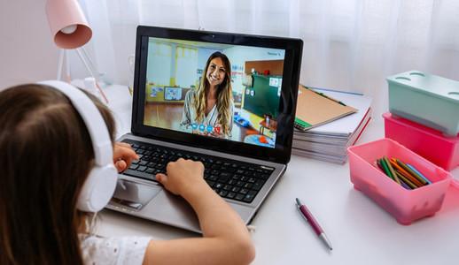 Laptop with teacher teaching class via videoconference