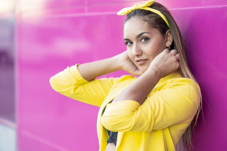 Young woman wearing a yellow jacket and headband