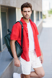 Fashionable man standing outdoors wearing casual clothes