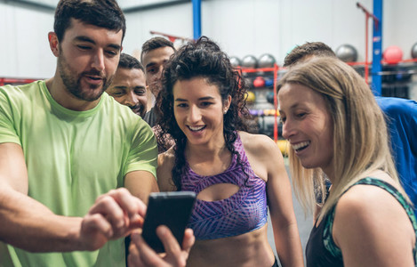 Athletes looking at the mobile of a gym mate