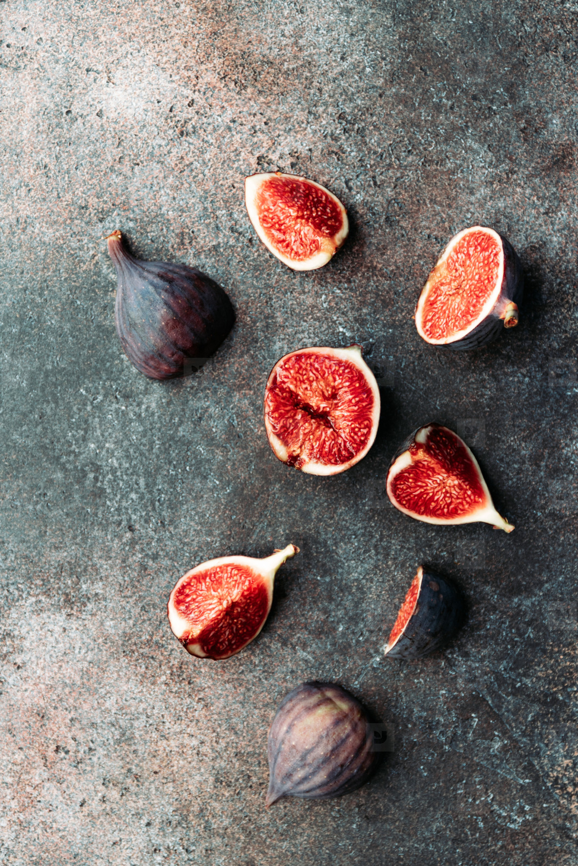 Top view of fresh ripe cutted figs on the textured background