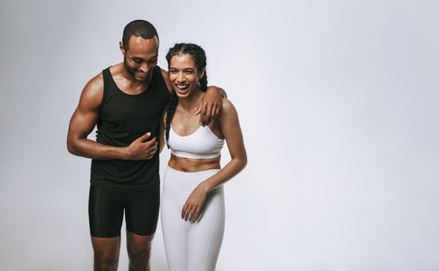Monochrome portrait of fit man and woman together