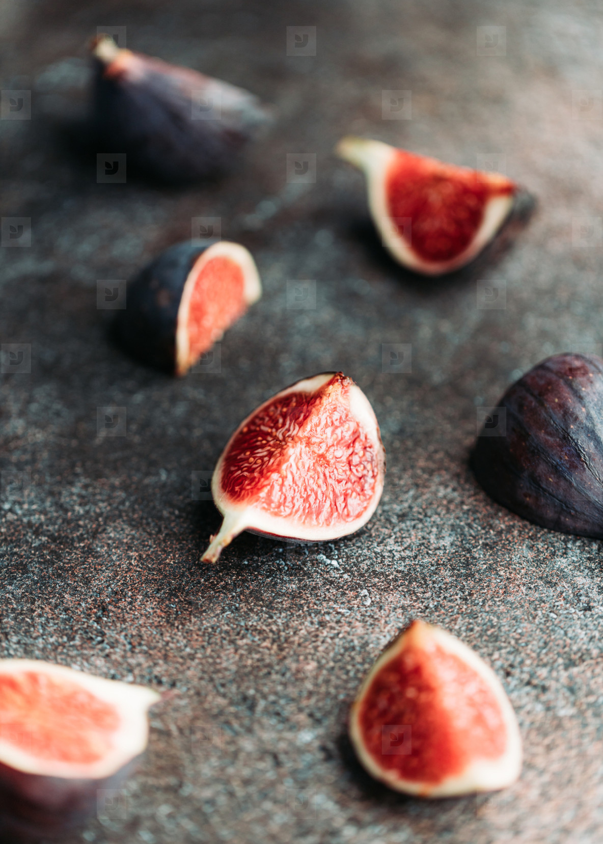 Macro photography of fresh ripe cutted figs on the textured background