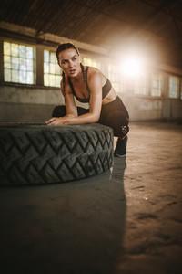 Woman taking a break from cross training workout