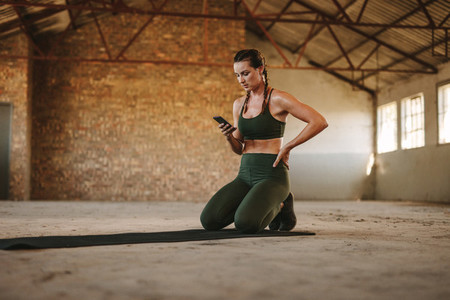 Fitness woman taking break after workout