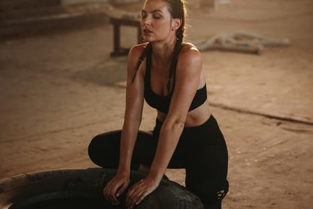 Woman taking break after cross training workout