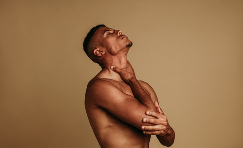 Muscular african american man holding his throat