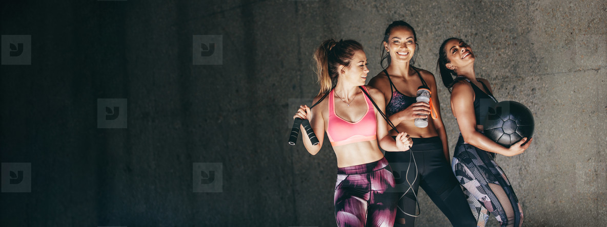 Group of female friends relaxing after workout