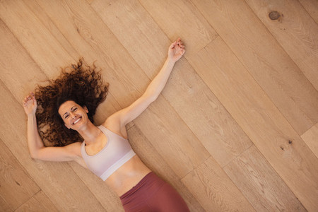 Woman relaxing on floor after workout