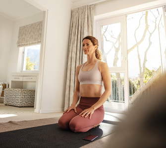 Woman exercising indoors in morning