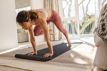 Woman at home practicing yoga