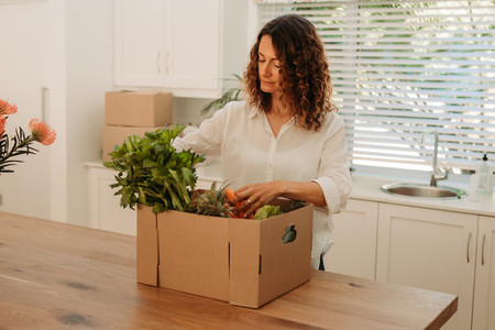 Woman checking home delivered groceries