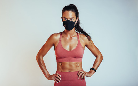 Woman with muscualr body wearing face mask