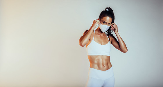 Sporty woman with medical mask