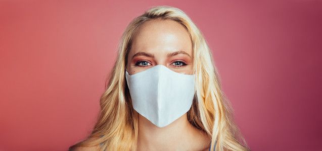 Blonde woman in a protective face mask