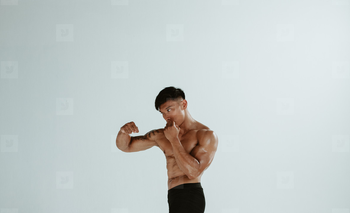Fit male practising shadowboxing