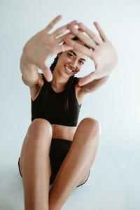 Sportswoman making finger frame