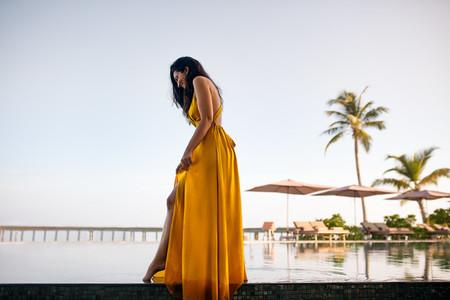 Tourist woman enjoying holiday at a resort