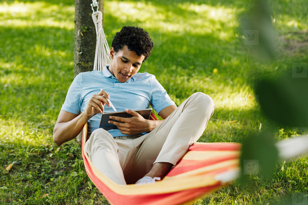 Teenager lying in a hammock