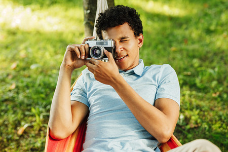 Young man making photographs