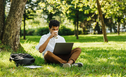 Male student drinking coffee