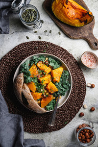 Top view of season salad with grilled pumpkin  kale  chickpea  pepitas and nuts  Autumn vegetarian healthy recipe