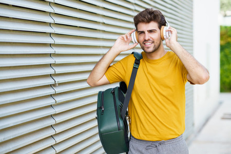 Young man with headphones in urban background