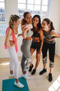 Fitness women enjoying a selfie after workout