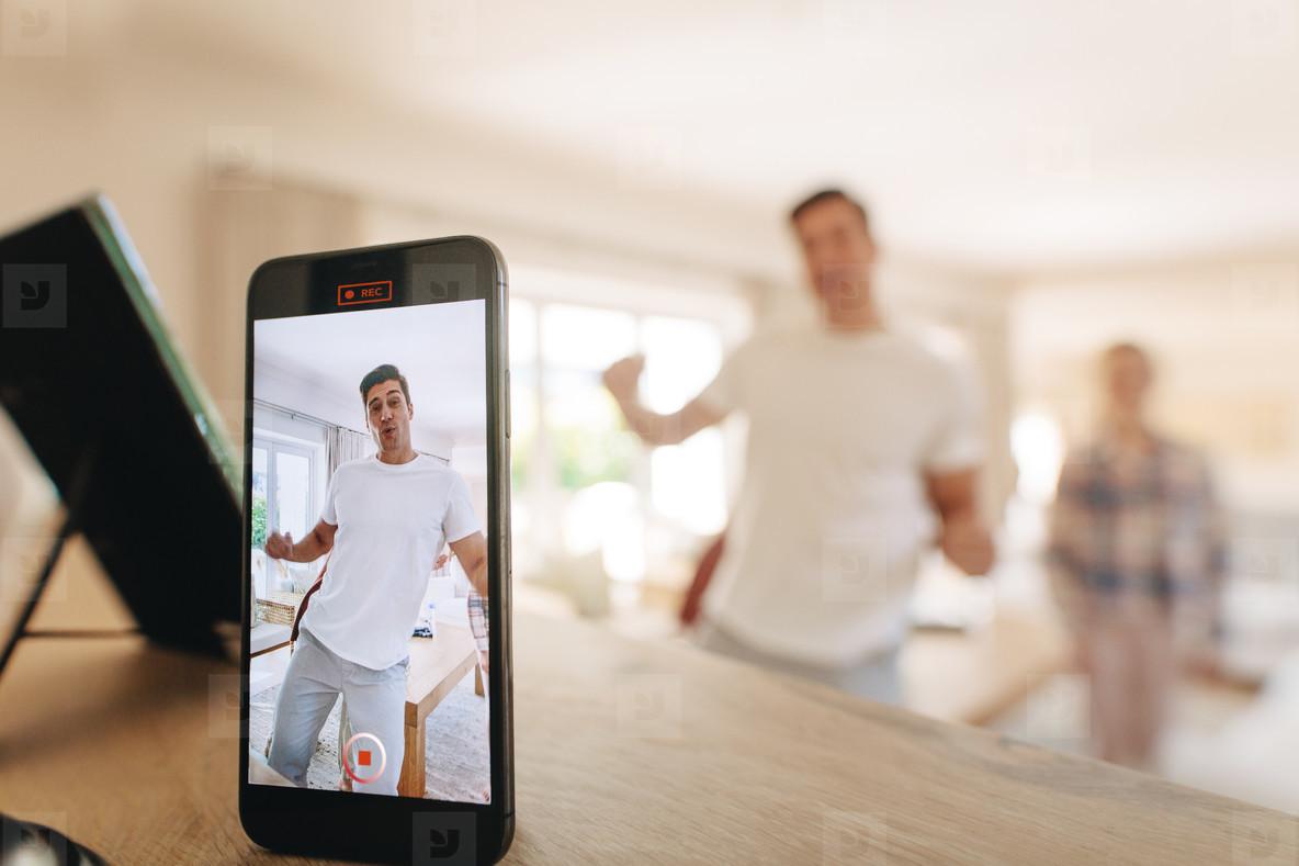Man dancing to upload on social media app