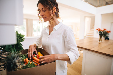 Woman checking online purchased groceries