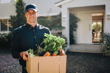 Man delivering grocery to home address