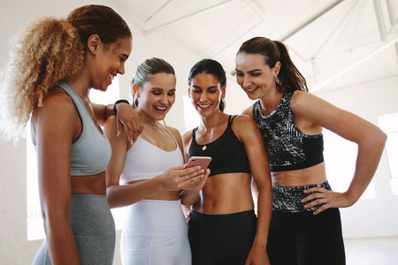 Gym women looking at mobile phone