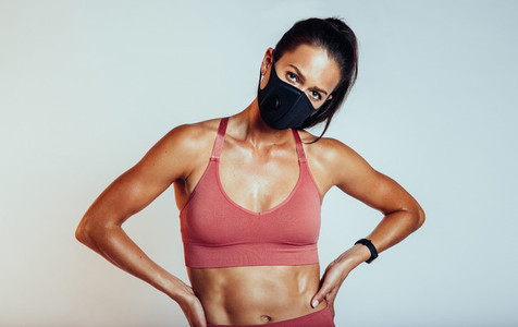 Muscular woman with face mask
