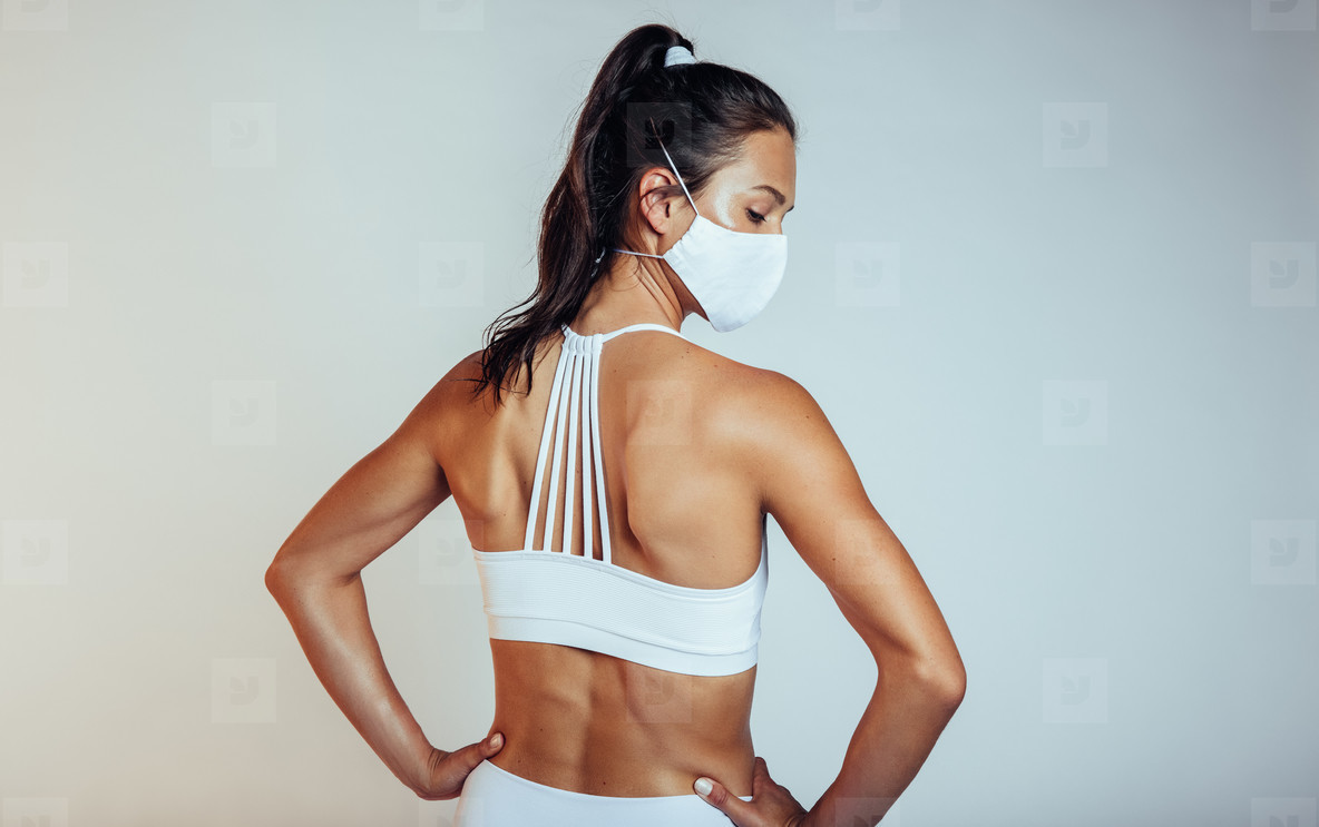 Woman in sportswear with protective face