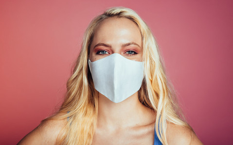 Woman wearing a face mask to prevent from corona virus