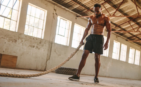 Man taking rest after battle rope workout