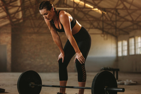 Woman taking rest after weight lifting workout