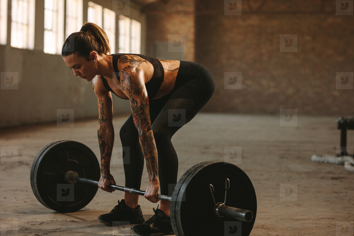 Fitness woman doing weightlifting workout