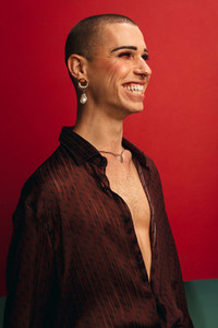 Smiling gay man wearing with earring