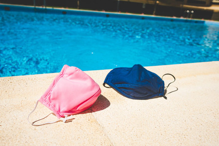 Protective mask near a swimming pool in summer