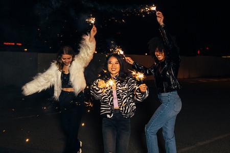 Three stylish girls having fun